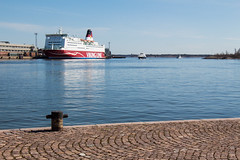 Arrival (KevPBur) Tags: blue sea reflection water ferry port suomi finland spring helsinki harbour jetty sunny cobblestones vikingline belgianblock canon650d settpaving canonefs18135mmf3556isstm canonrebelt4i canonkissx6i canon650dcanonkissx6icanonrebelt4i