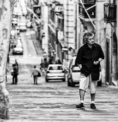 People of Valletta (zilverbat.) Tags: portrait people urban blackandwhite bw man blur blanco monochrome photography town blackwhite scenery noir dof zwartwit bokeh negro citylife streetphotography streetscene malta timelife innercity cinematic portret blanc valletta streetshot urbanlife zw streetcandid peopleinthecity straatfotografie blackwhitephotos straatportret straatfotograaf zwartwitfotografie zilverbat