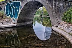 Somewhere in Vienna (A.B. Art) Tags: vienna wien park bridge reflection water graffiti austria wasser brcke spiegelung wasserpark floridotower