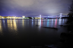 MHB (Chris Whit) Tags: city longexposure bridge trees winter sky water colors skyline clouds canon buildings lights log bare tokina poughkeepsie ripples f28 t3i hudsonvalley midhudsonbridge 1117mm teamcanon walkwayoverthehudson chriswhitphoto