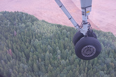 Touching base (Yurimi) Tags: tractor forest aircraft air wheels landinggear land airborn