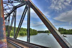 Talkeetna RR Bridge - Color Version (magnetic_red) Tags: old railroad travel bridge blue trees sky alaska clouds train river rust rivets steel rusted