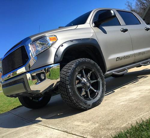 Brushed titanium wrap with matching wheels. #vehiclewraps #ordinaryisnotanoption #charlottevehiclewraps #3mwraps