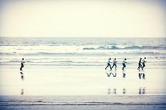 Catching up (irishman67) Tags: ocean ireland blackandwhite beach monochrome lahinch coclare