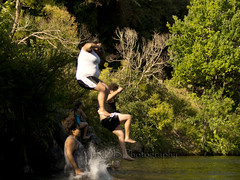 Cliff Jumping 09 (C & R Driver-Burgess) Tags: girls shadow cliff men fall boys water forest river high jump bush women alone body air hills together shade maori splash sunlit leap scrub banks hurl pakeha