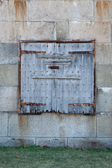 Fort Wadsworth Details-3 (Erin Cadigan Photography) Tags: hinge wood old texture vertical stone architecture danger vintage concrete scary ruins rivets fort decay military details rustic security structure architectural retro creepy spooky bunker shutter horror weathered concept conceptual protection hazard thriller suspense fortwadsworth