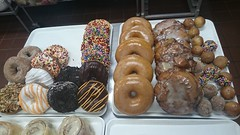 Donuts and Apple Fritters (tasteoflovebakery) Tags: apple cake holes sprinkles donuts glazed frosted fritters
