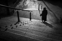 Old Woman and stairs (hzeta) Tags: street old city autumn light bw woman white black fall blanco luz silhouette backlight stairs contrast contraluz person persona calle mujer y negro vieja ciudad bn contraste otoo handrail backlit silueta anciana escaleras baranda escalinatas