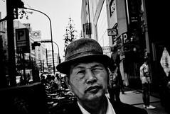 Cool Japanese guy (Jiajun Yang) Tags: street leica hat blackwhite day voigtlander streetphotography m82 monochrone voigtlandernokton35mmf14sc