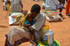 A drought-hit family in Puntland receive food aid (Ummah Welfare Trust) Tags: poverty africa charity food water children hope desert islam aid hunger muslims development humanitarian somalia somaliland developing puntland humanitarianism nugaal awdal