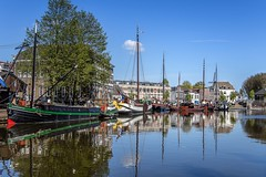 A ship in harbour is safe, but that's not what ships were designed for (Peter Jaspers) Tags: blue sky history windmill dutch clouds sailboat reflections olympus panasonic netherland vest tjalk omd gouda luchten 2016 em10 tslot klipper havenmuseum harbourmuseum 20mm17 buurtje frompeterj