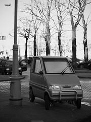 """CANTA"" on the street (Long Sleeper) Tags: street trees bw holland tree cars monochrome car amsterdam automobile thenetherlands vehicle microcar dmcgx1 lumixg425mmf17asph"
