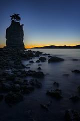 Siwash Rock (fernandobrandaodebraga) Tags: ocean longexposure sunset reflection water vancouver landscape rocks bc sony lookout siwashrock clearsky a6000