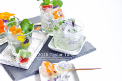 Edible Flower Ice Cube (TailorTang) Tags: summer stilllife food 50mm drink mint homemade borage homegrown icecube nasturtium 5014 foodphotography violas edibleflower