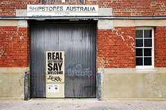 Warehouse Door (Macr1) Tags: door camera copyright lens outdoors day cloudy refugees sony australia location warehouse wa 5100 aus fremantle westernaustralia conditions politicalstatement politicalasylum markmcintosh macr237gmailcom selp18105g 5100 markmcintosh sonyepz18105mmf4goss ilce5100 sonyilce5100 sony5100 sony5100