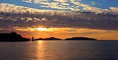 The Mediterranean Sea @ Sunset (Hlne_D) Tags: sunset sea cloud mer lighthouse france marseille ile paca aviary provence nuage phare mediterraneansea vieuxport coucherdesoleil j4 le mditerrane bouchesdurhne frioul mermditerrane ilesdufrioul chteaudif provencealpesctedazur lesdufrioul hlned planetearthsunrisesunsets pharedeladsirade