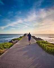 iInspire (Kartik Malik) Tags: ocean morning blue sea sunlight inspiration newcastle nikon earlymorning bluesky running motivation nikkor runner inspire d90 energetic getoffurass kartikmalik kartikmalikgmailcom