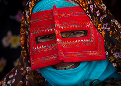 a bandari woman wearing a traditional mask called the burqa at panjshambe bazar thursday market, Hormozgan, Minab, Iran (Eric Lafforgue) Tags: red people woman face horizontal outdoors persian clothing asia veil mask iran market muslim islam religion hijab culture persia headshot hidden covered iranian bazaar adults adultsonly oneperson islamic traditionaldress burqa customs ethnicity middleeastern frontview sunni burka chador balouch hormozgan onewomanonly lookingatcamera burqua  bandari  embroidering 1people  iro thursdaymarket  minab unrecognizableperson colourpicture  borqe panjshambe panjshambebazar iran034i2785 boregheh