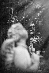 Forgotten iii (Eric Baggett) Tags: tree film monochrome angel analog dark religious noir decay fineart gothic creepy grainy damaged statuary lowkey somber bnw olympus35mmis20 ericbaggett
