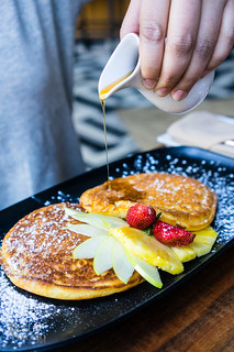 Buttermilk pancakes with apple saffron, berry compote, maple syrup