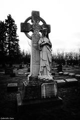 St. Mary's Cemetery (Gabrielle Gaia) Tags: blackandwhite sculpture cemetery grave graveyard statue illinois catholic cross il crucifix stmary peoria stmaryscemetery catholiccemetery westpeoria