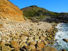 Stony Ground! ('cosmicgirl1960' NEW CANON CAMERA) Tags: blue sea sky green water golden rocks cornwall stones cliffs boulders yabbadabbadoo cotvalley porthnanven