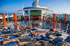 Cruising the Caribbean (19seconds) Tags: cruise sea sky people sun football holidays ship relaxing screen caribbean sunbathing consumerism onboard sunbeds