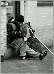 'Big Issue' seller (* RICHARD M) Tags: poverty street winter cold liverpool magazine mono blackwhite sad candid homeless poor sneakers trainers gloves february pitiful crutch destitute merseyside destitution homelessness bigissue hardtimes signofthetimes winterclothes toughtimes magazineseller disadvantaged bigissueseller heartrending signofourtimes plight keepingwarm winterclothing stayingwarm joggingpants glovedhands joggingbottoms bigissuenorth