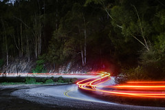 slithering back down (pbo31) Tags: california road winter red motion black color night dark oakland march lowlight nikon snake down hills bayarea eastbay curve alamedacounty slithering 2016 lightstream skylineboulevard boury pbo31 d810 forestland