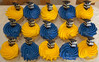 Graduation Cupcakes (Spike's Shoes) Tags: blue school decorations food usa home cakes colors minnesota yellow horizontal america cupcakes pattern bright artistic top united north graduation tasty indoor books celebration delicious cap american gaudy inside swirl states decorate mn tassel frosted swirling garish brash brassy mahtomedi morterboard