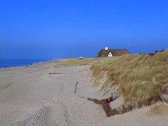 Hidden Behind The Dunes (ivlys) Tags: blue sea sky beach nature strand germany landscape island deutschland sand meer dune himmel insel northsea sylt landschaft nordsee allemagne dne schleswigholstein ivlys