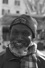 Vendor in market square (Federico Pitto) Tags: bw d76 nikonfe2 nikkor50mm18 rolleirpx400