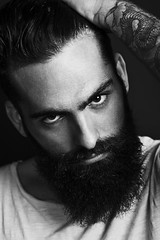 B/w portrait of a bearded man (perpetualinsights) Tags: portrait people man black cute sexy guy art beauty face look fashion tattoo dark hair beard person cool model adult serious masculine expression muscular ominous hipster young handsome evil posing lifestyle trendy attractive casual rough elegant relaxed hairstyle macho sullen bristle furious stylish confidence elegance fashionable cruel confrontation hooligan expressing