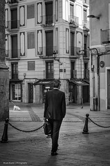 The executive and the poodle (Luis Alvarez Marra) Tags: street camera bw white black lens 50mm prime spain nikon flickr faces candid creative commons catalonia crop soul moment executive reus decisive unpossed d7000 streettog