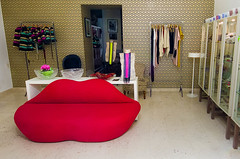 Where many a-slipped 'twixt  the cup and the lip... (Jumpin'Jack) Tags: window fashion shop design weird back store 60s funny shaped joke couch r lip accessories quirky pun viewed dominating punny throughthe