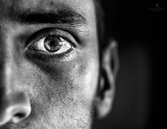 Look at my eye and I'll tell you my story (hector_cbs) Tags: portrait people blackandwhite black eye texture blancoynegro monochrome shadows darkness background surreal lowkey selfie