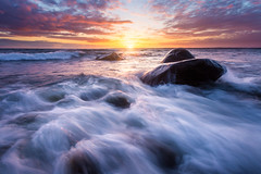 Rush (Arvid Bjrkqvist) Tags: ocean light sunset sea sky sun motion water colors beautiful clouds reflections rocks waves dynamic sweden stones vivid rays sa kungsbacka nsbokrok