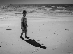 In the Shadows (pxlline) Tags: shadow sea beach water mono cambodia child candid streetphotography kh preahsihanouk krongpreahsihanouk
