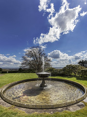 Lydney Park, Gloucestershire, UK (Christopher Smith1) Tags: park uk portrait sky water fountain vertical gardens clouds contrast river pond view gloucestershire severn feature lydney