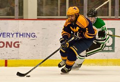 Intensity (R.A. Killmer) Tags: white green ice hockey intense fast skate stick puck tough wvu skill sru