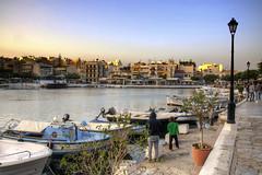 golden time (Tony Shertila) Tags: travel sunset sky water weather geotagged boats europe day glow outdoor tourist clear greece crete grece thelake goldenlight grc agiosnikolaos geo:lat=3519015585 geo:lon=2571773887