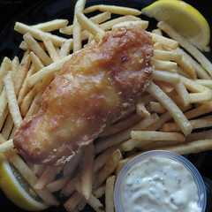 Beer battered fish & chips (Coyoty) Tags: lighting stilllife food brown white fish college beer yellow fruit circle square crust cafe potatoes still lemon bokeh sauce connecticut ct chips diagonal crispy fries squareformat round seafood fried farmington tartar tartarsauce battered cornercafe tunxiscommunitycollege