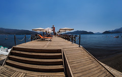 Wooden sea walk. (CWhatPhotos) Tags: cwhatphotos people marmaris olympus samyang fisheye fish eye 75mm wide angle prime lens water holiday june 2015 photographs photograph pics pictures pic image images foto fotos photography artistic that have which contain digital bythe bikini blue turkey sea beach wear sand walk sky skies clear day hot sunny sun aegeonn aegean turkish hols manual focus