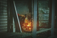 Let's do some metal work. (jerichopaolodris) Tags: life street people urban metal fire person photography photo candid flames philippines streetphotography structure manila cutting stolen urbex