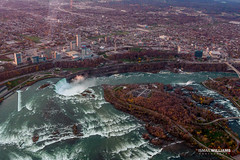 Niagara Sky Shot 5 (ismailwilliams) Tags: city bridge sunset sky usa sun mist ny newyork canada water canon buildings river landscape flow happy fly us stream top niagara falls helicopter land damm maiden 60d