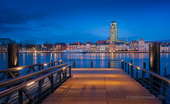 Blue hour Deventer (Bredewoldski) Tags: nightphotography blue holland reflection church netherlands skyline architecture night river dark pier nikon blauw cityscape nightshot martin nacht nederland le hour avond f4 hdr deventer ijssel afs architectuur nachtfotografie spiegeling uur d610 1635mm avondfotografie bredewold stadsgezicht nachtopname ijsselkade uurtje triggertrap bredewoldski