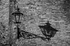 Old Street Lamp (judithrouge) Tags: street old shadow blackandwhite lamp wall lampe alt monochromatic schwarzweiss schatten korn mauer ziegel