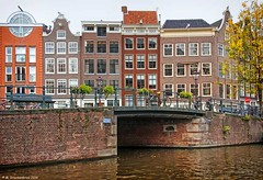 Canal houses along the Prinsengracht in Amsterdam (PhotosToArtByMike) Tags: bridge holland netherlands dutch amsterdam canal bikes prinsengracht houseboats prinsengrachtcanal canalhouse grachtengordel canalring