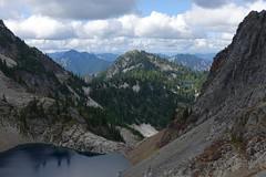 Chair Peak Lake from Melakwa Pass (Sean Munson) Tags: alpinelakeswilderness alpinelakeswildernessarea chairpeaklake gemlake hiking mountbakersnoqualmienationalforest mountwright mountains mtbakersnoqualmienationalforest mtwright nationalforest washington landscape