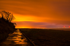 Umber (joshuacolephoto) Tags: bridge winter sunset red orange tree water silhouette night clouds river bristol landscape puddle nikon nightscape dusk path jetty branches severn burnt d750 raining refelection